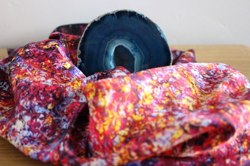 Aithne Vibrations of Carmine Scarf surrounding a Blue Agate Geode Crystal