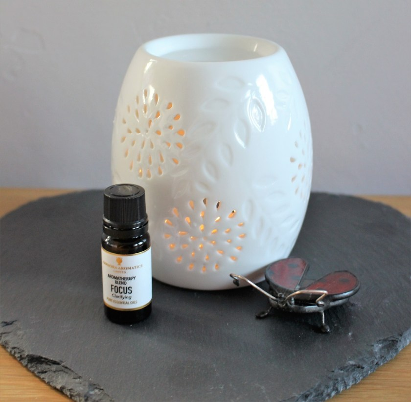 Getting Focused with Amphora Aromatics - Picture of oil and ceramic burner, sat on a slate heart