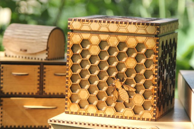 Unique box featuring an intricate honeycomb and bees