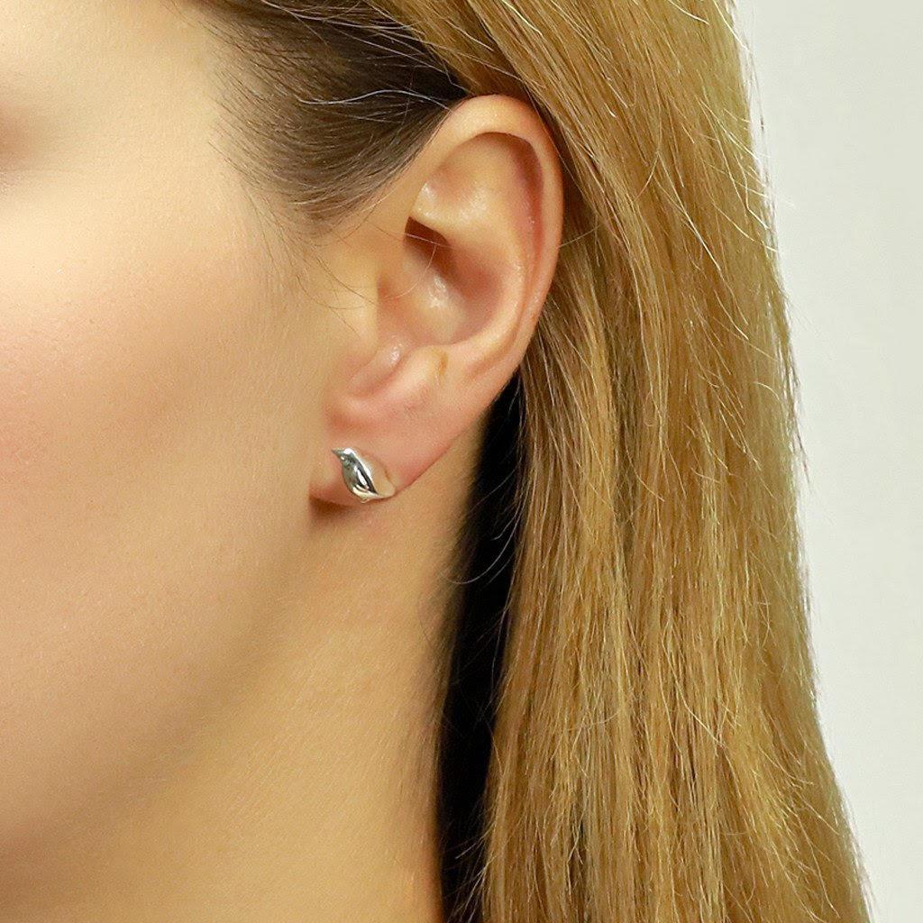 penguin earrings being warn