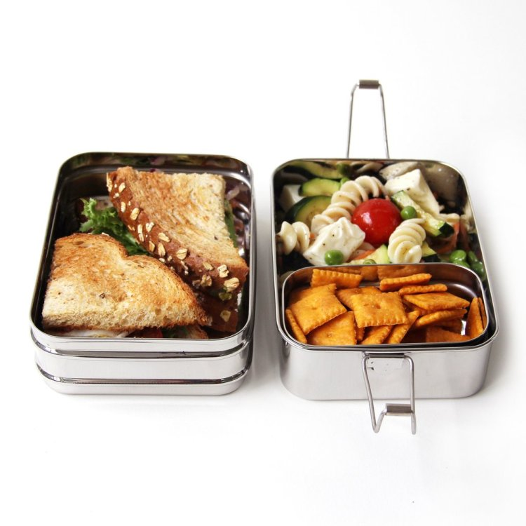 Say goodbye to plastic baggies and other leachy plastic food containers with the stainless steel ECOlunchbox Three-in-One.
