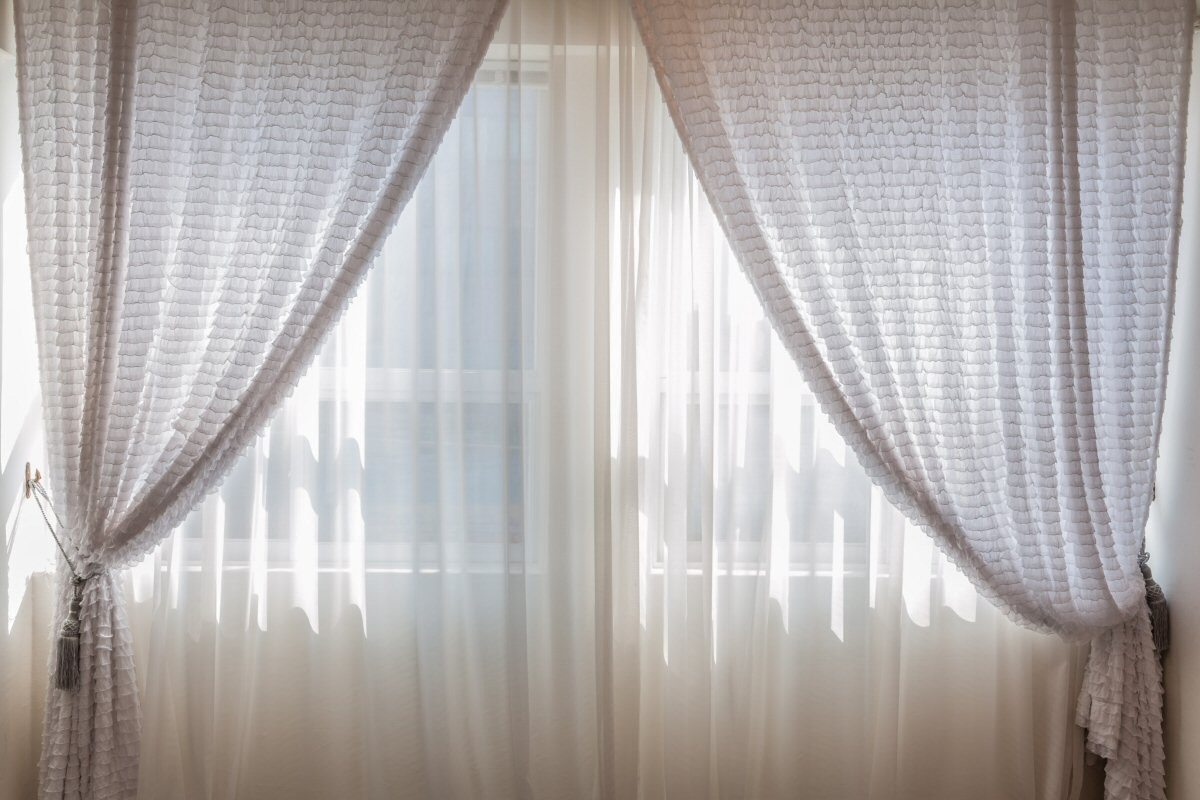 5 Winter Mistakes That Will Leave You Feeling Cold - Leaving Curtains Closed on Sunny Days