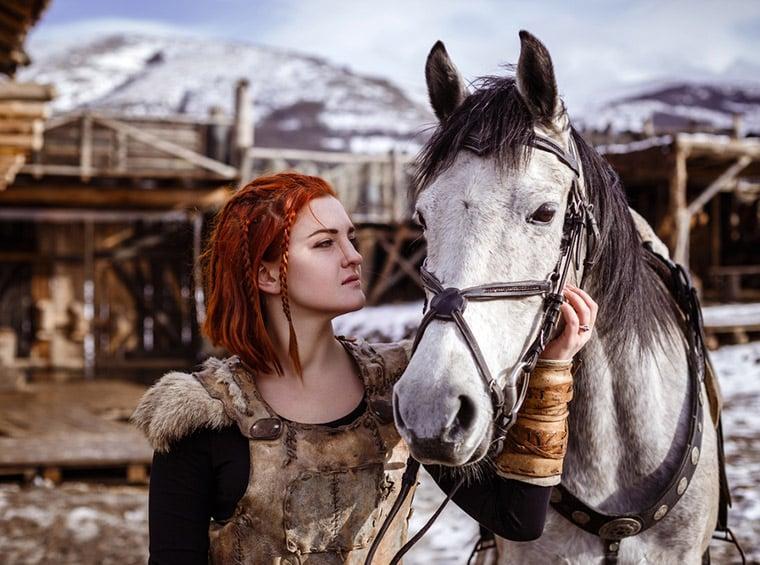 Viking woman with horse on a Scandinavian farm