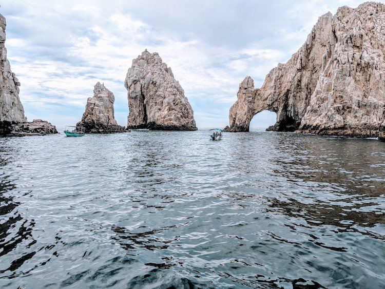 Canexican Tour stops for a great photo opp at the Archway of Cabo San Lucas.