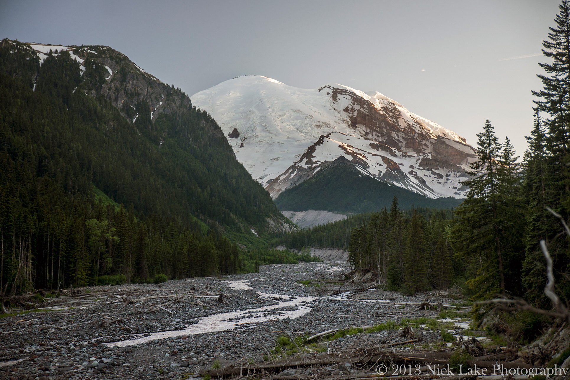 Mt. Rainier looms above White River at sunset