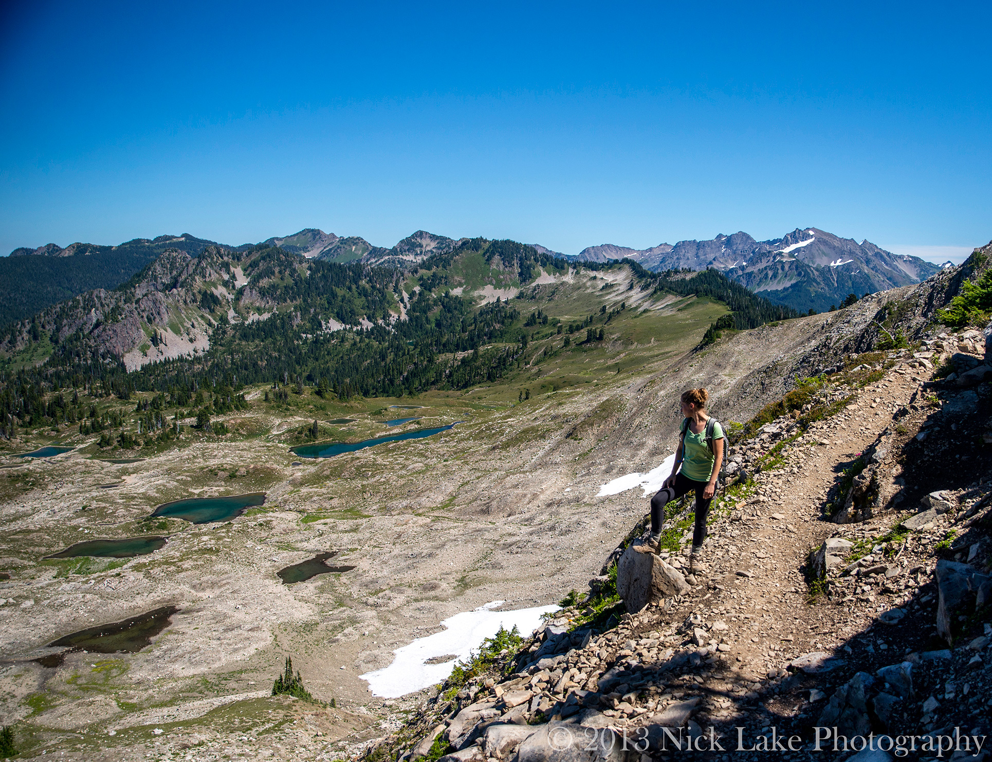 Woman Hiking Seven Lakes Basin on High Divide Trail Olympic National Park Washington