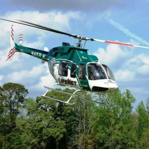 LifeNet Air Medical Helicopter Ambulance landing in trees Hot Springs