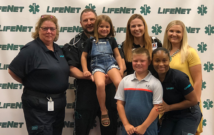 LifeNet Lifesaver Award - Weston Phelps & Kristen Janes with LifeNet EMS Crews
