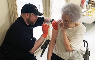 LifeNet Paramedic gives a flu shot in Stillwater