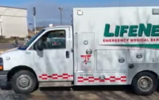 LifeNet ambulance drives in the 2018 Toys for Tots Parade in Texarkana near Central Mall.