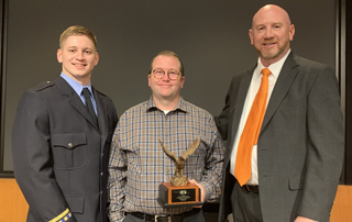 Hunter Poston, Patrick Cody, and Kelly McCauley pose for a photo after the OKAMA Stars of Life Banquet in 2019.