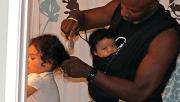 father brushing daughter