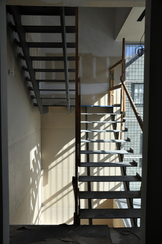 modern steel stairs - windows and gypsum board walls in place