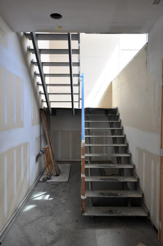 modern steel stairs - stainless steel handrail construction begins
