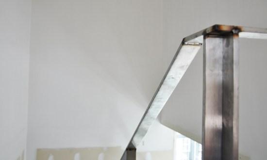 modern stairs - stainless steel handrail spot welds