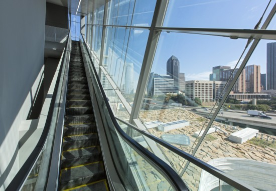Glass-encased escalator overlooking downtown Dallas - Mark Knight Photography