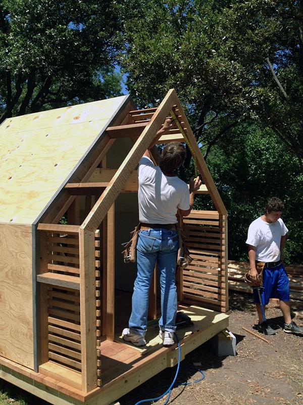 Lantern Playhouse cedar slats are installed