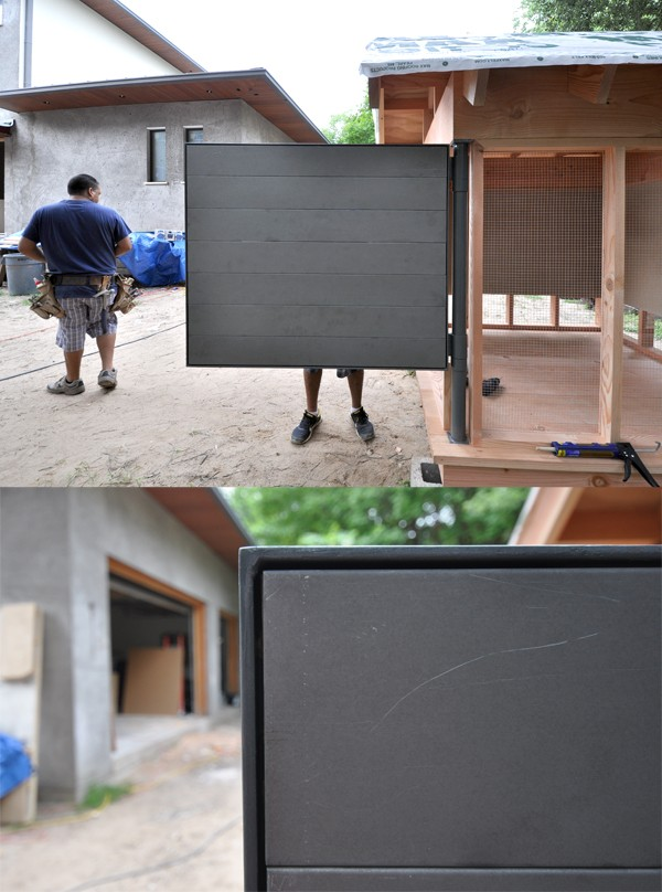 Movie Theater Playhouse by Bob Borson metal door and boards corner detail