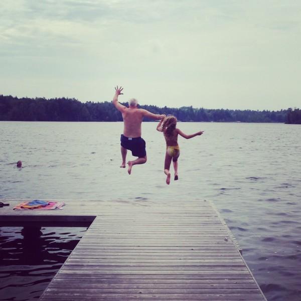 Kate and Bob Borson jumping off a dock