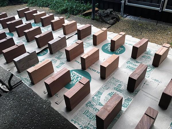 preparing to add polyurethane to LoaA Playhouse trophy wood blocks