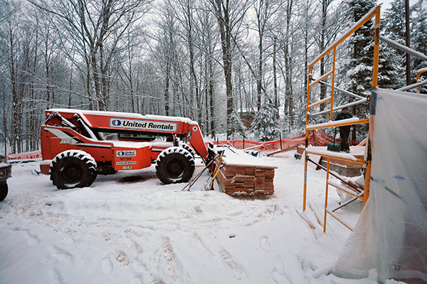 construction equipment covered in snow