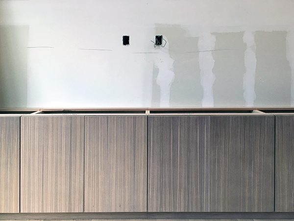 Cabinetry scribed to wall