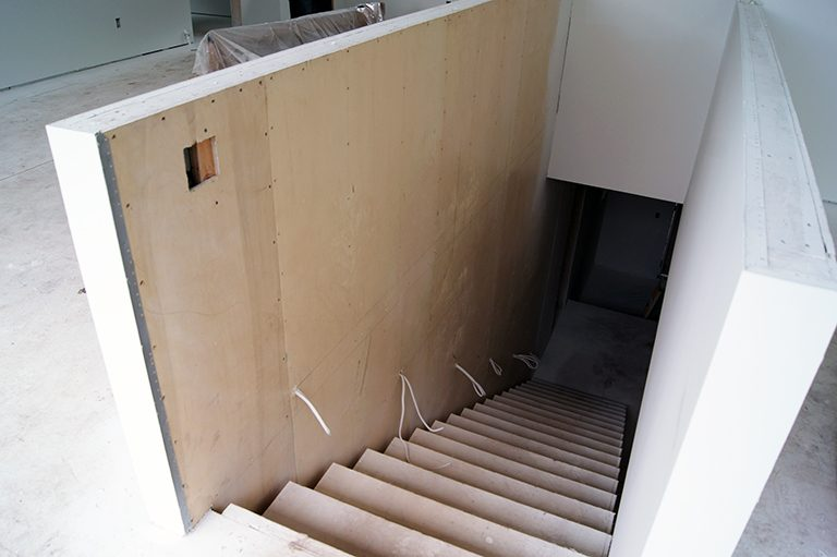 steel wall with plywood backing