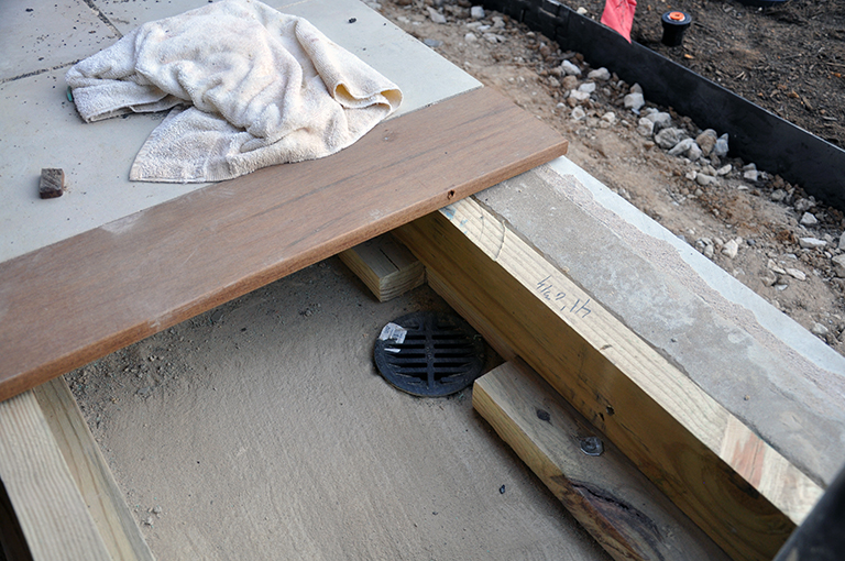 Drain set in slab under Ipe wood deck