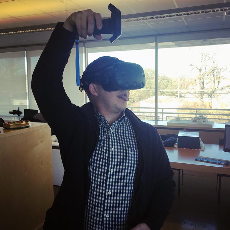 Landon Williams, of MMB Architects, using VR headgear