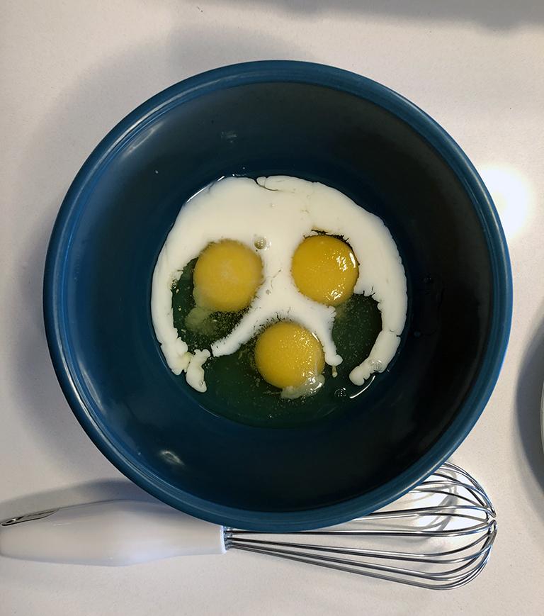 preparing eggs for breakfast