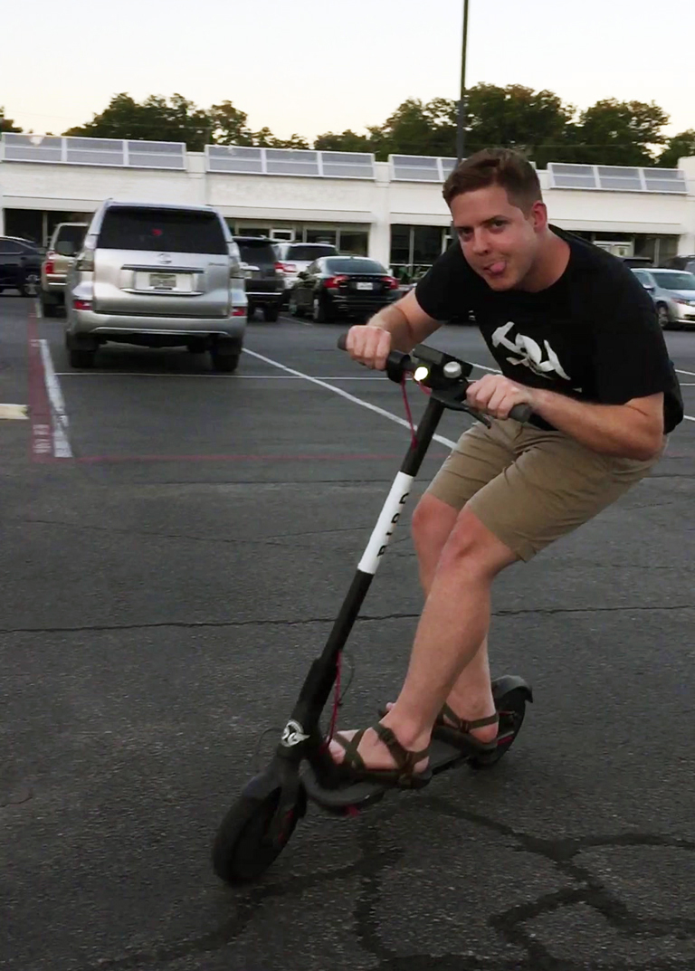 Landon Williams on a Bird Scooterq