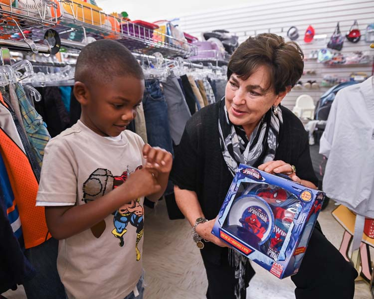 Upscale Resale manager with boy with toy