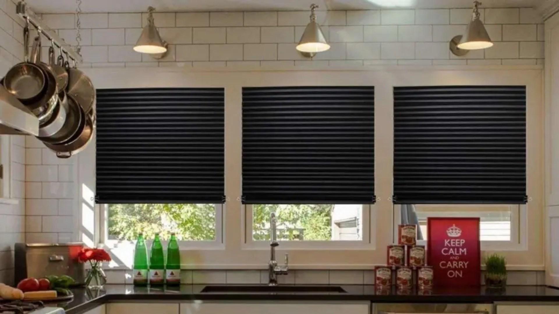 Three windows with black shades