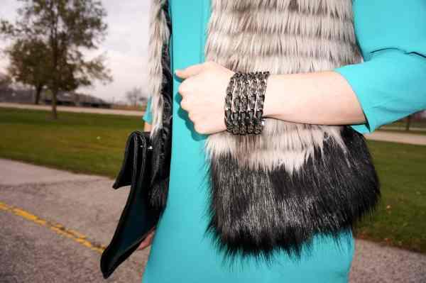 link bracelet, fur vest