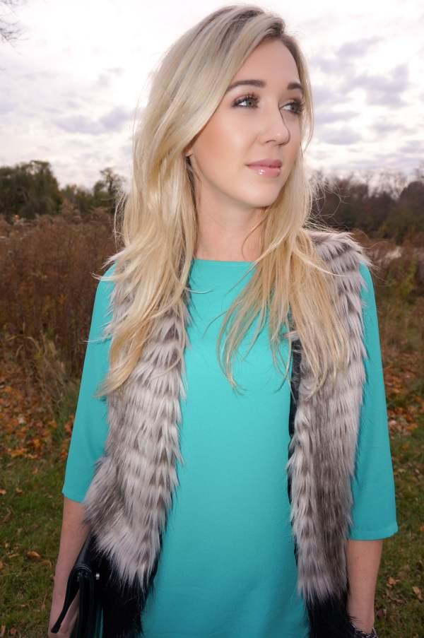 teal dress, fur vest