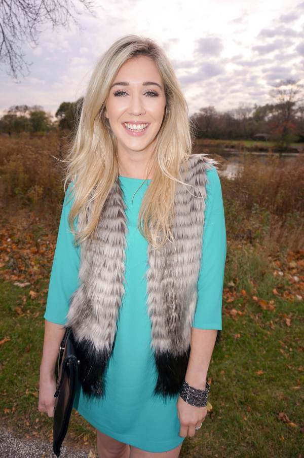 teal dress, fur vest