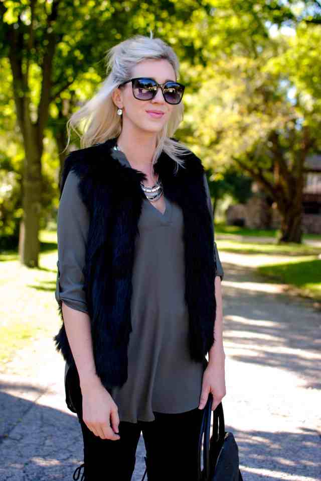 black faux fur vest, green tunic