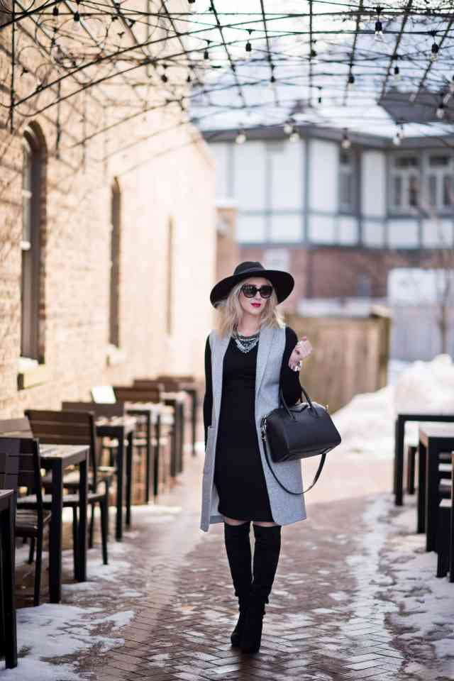 long vest, over the knee boots, hat