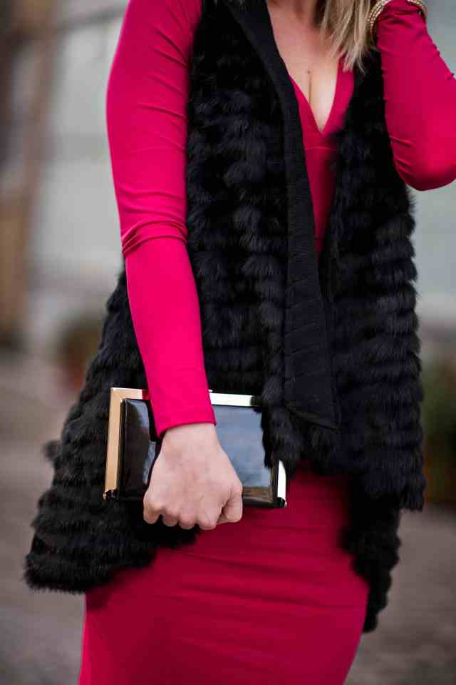fur vest, black clutch