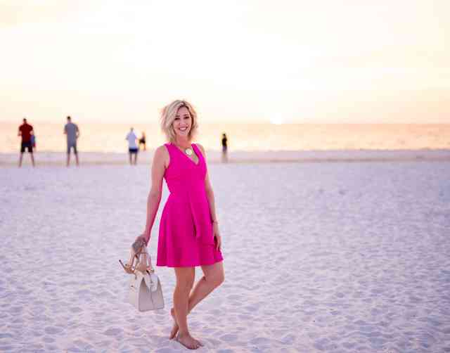 hot pink dress on the beach