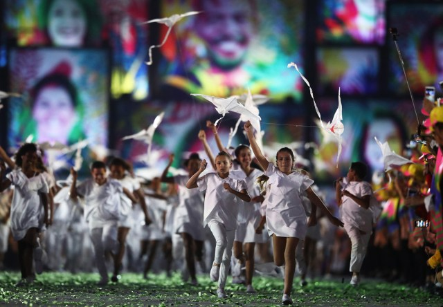 Young performers run into Maracana Stadium on August 5, 2016