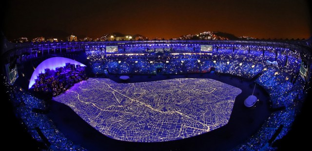 A street map and mockup of a favela fill the floor of Maracana Stadium during the opening ceremony.