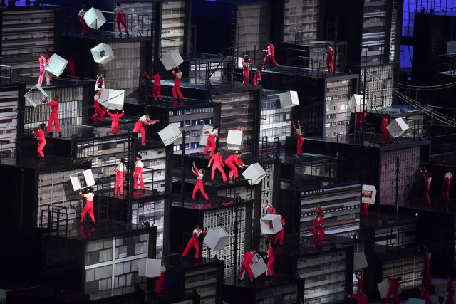 Performers scale mock buildings in Maracana Stadium during the Olympic Opening Ceremony. #