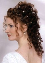 acconciature sposa capelli ricci lunghi