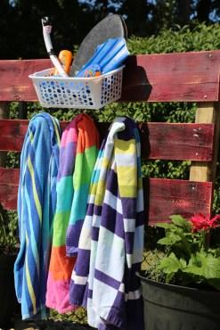diy pool toy storage rack planters wood beams towel hanger