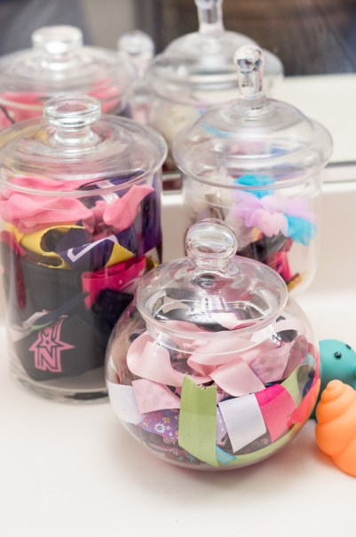 Bathroom Organization Ideas: Apothecary jars to organize hair supplies and toiletries on the counter top