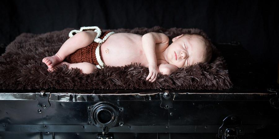 Newborn on hope chest