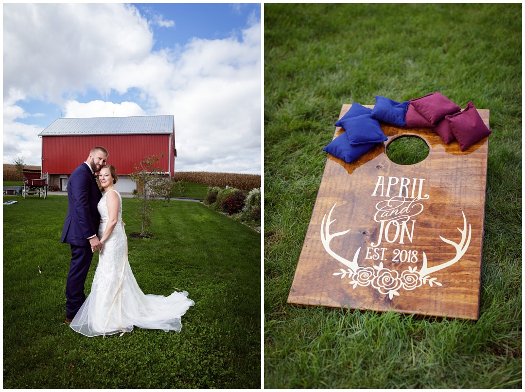 bride and groom poses with barn