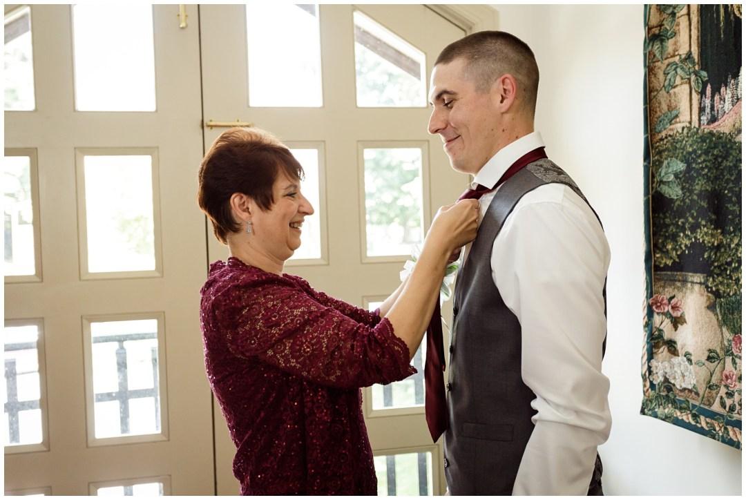 mom asissting groom pre-wedding