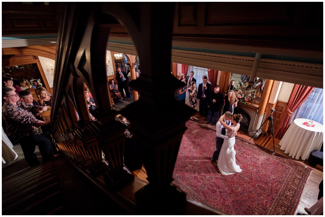bride and groom dance at historic hotel
